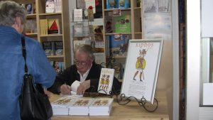 Book signing. Trying hard to concentrate.
